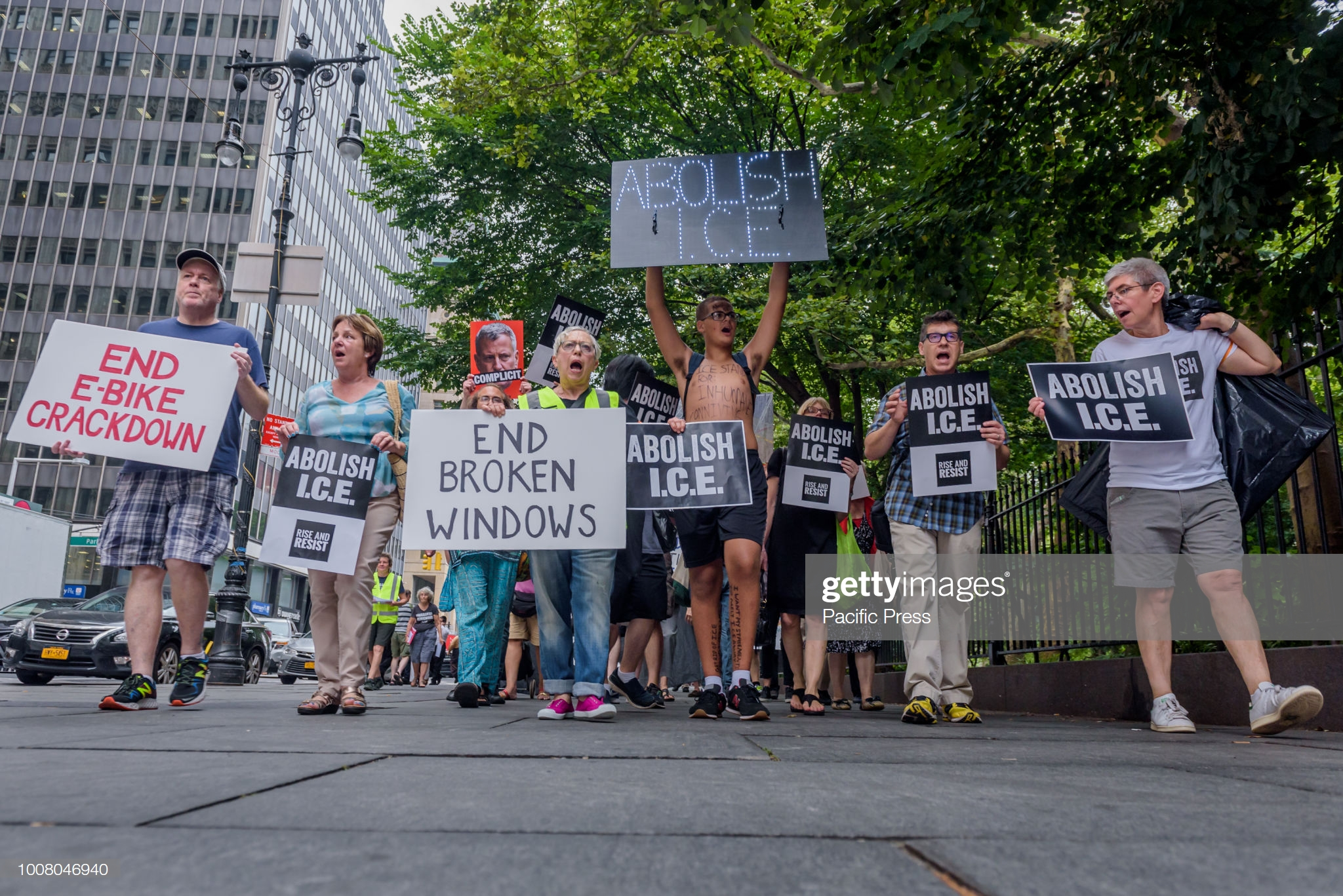 CITY HALL, NEW YORK, UNITED STATES - 2018/07/30: Members of the activist group Rise and Resist organized a protest outside New York City Hall on July 30, 2018 as part of the four days of protests targeting local politicians and businesses profiting from ICE. Activists demand Mayor De Blasio to follow the lead of other cities, states, and lawmakers by standing up to ICE. (Photo by Erik McGregor/Pacific Press/LightRocket via Getty Images)