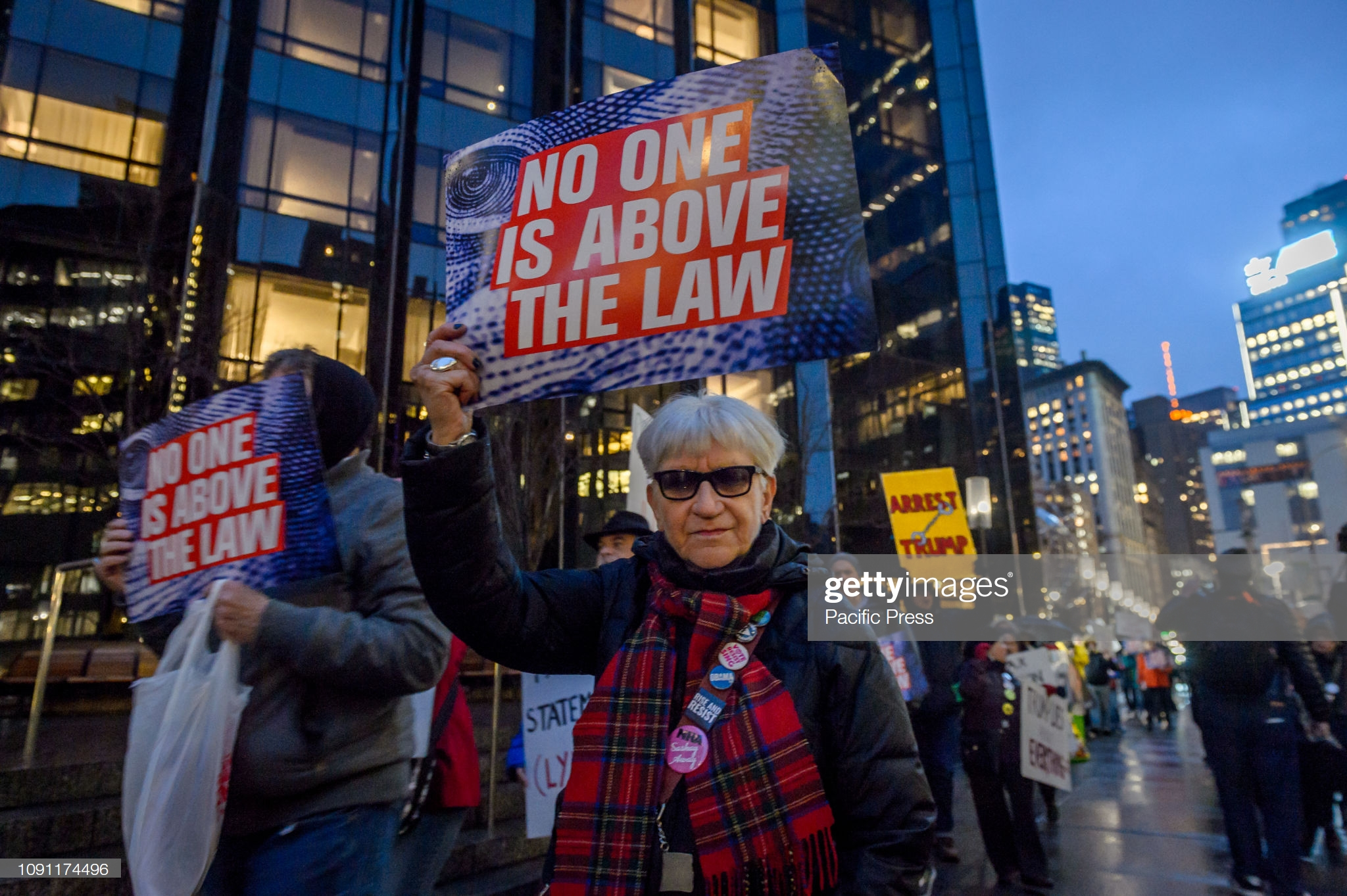 """TRUMP INTERNATIONAL HOTEL AT COLUMBUS CIRCLE, NEW YORK, UNITED STATES - 2019/01/29: Members of the activist group Rise and Resist held an """"Arrest Trump"""" protest outside the Trump International Hotel at Columbus Circle in Manhattan the day when the State of the Union was supposed to be delivered by Trump before the government shutdown. Rise and Resist demands the arrest of Trump for his multiple serious crimes against the people of the United States and other countries. (Photo by Erik McGregor/Pacific Press/LightRocket via Getty Images)"""
