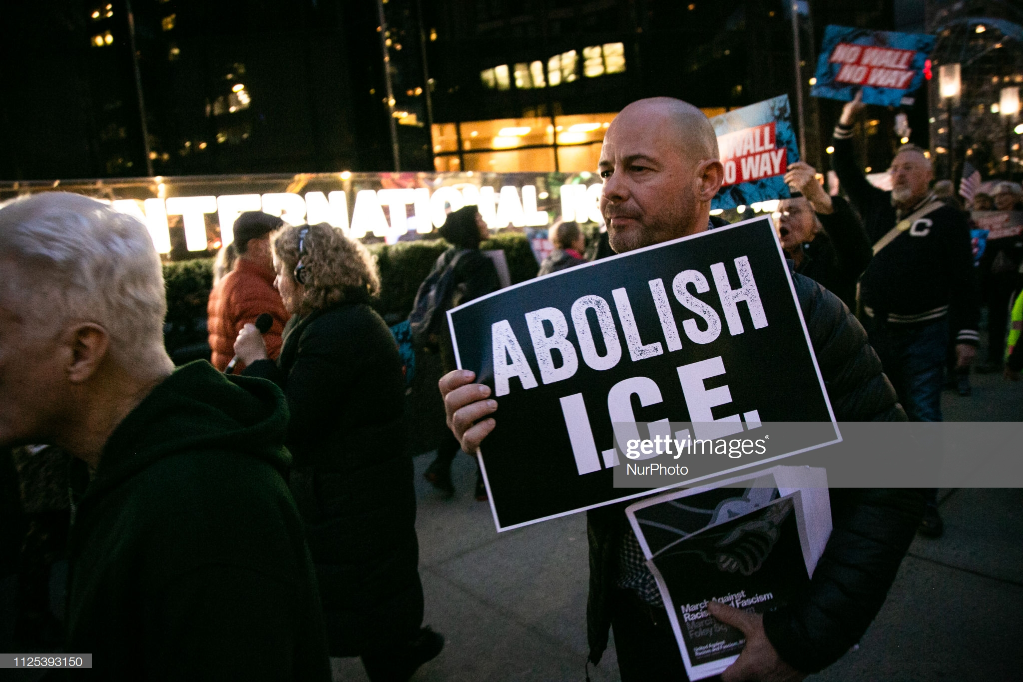 People hold signs that read 'Abolish I.C.E.' in front of Trump International Hotel on February 15, 2019 in New York City. The group is protesting U.S. President Donald Trump's declaration of a National Emergency in order to build his proposed border wall. (Photo by Karla Ann Cote/NurPhoto via Getty Images)